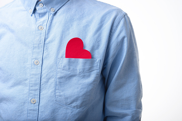 The Resilient Way article on compassion shows a red heart in the pocket of a man wearing a blue shirt